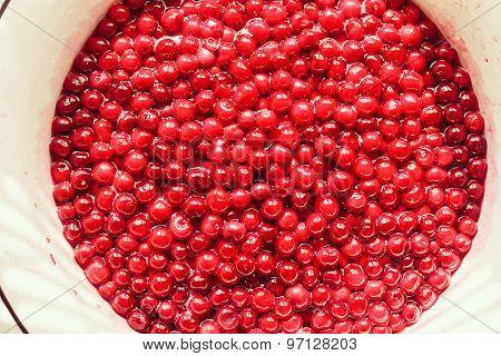 cherries in sugar syrup, cooking jam in big bowl