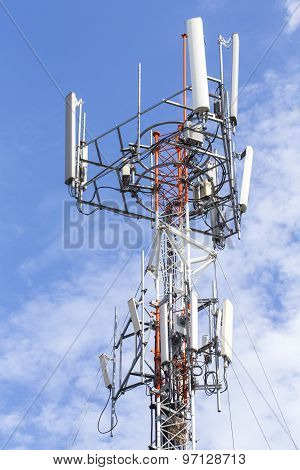 Cell Phone Tower With White Cloud And Blue Sky