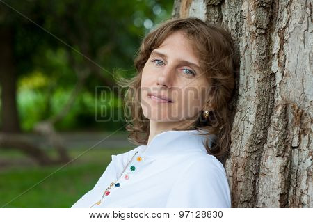 Middle age woman portrait in a park