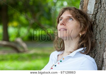 Middle age woman relaxes in a park