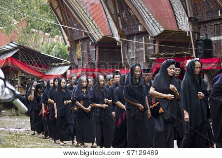 Women Procession At A Traditional Funeral Ceremony