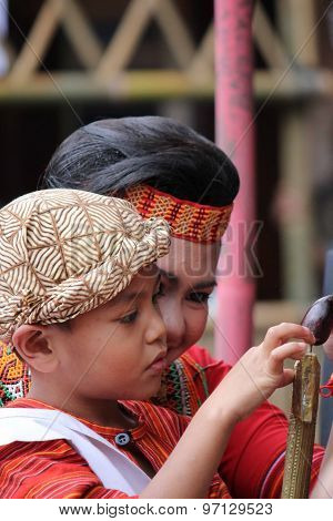 Young Indonesian Boy Playing With His Sister