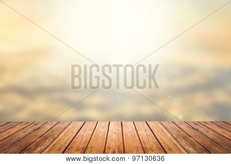 Wooden Floor With Sunset Sky Blurred Background