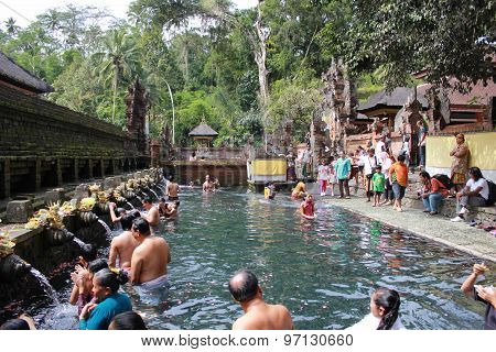 People Bathing At Sacred Fountains