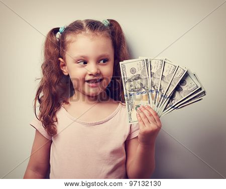 Happy Thinking Kid Girl Looking On The Money In The Hand And Joy. Vintage Closeup Portrait