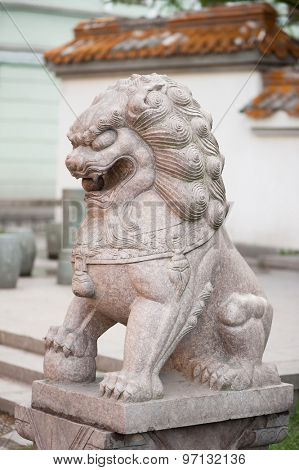 Stone statue of asian lion