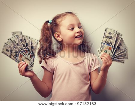 Happy Kid Girl Holding Cash Dollars And Looking With Smile. Vintage Closeup Portrait