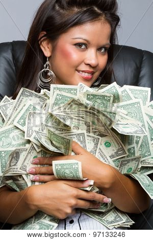 Beautiful woman holding pile of money