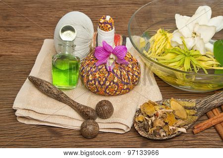Thai Spa Massage Setting With Thai  Herbal Compress Balls, Essential Oil Bottle, Towel,ylang-ylang F