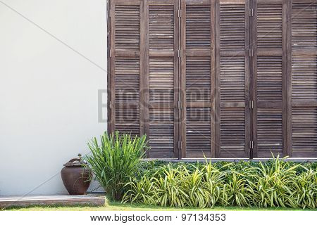 Background White Wall With Latticed Wooden Doors In The Tropical House