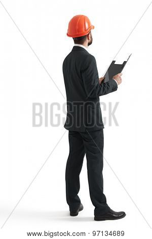 back view of businessman in orange helmet with black folder. isolated on white background