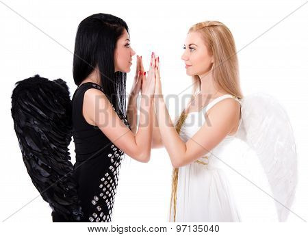 Beautiful Young Angel Playing Pat-a-cake With A Black Angel Isolated Over White Background