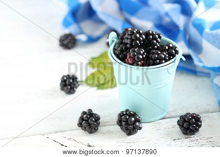 Beautiful Ripe Blackberry In Bucket On White Wooden Background