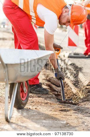 Street Workers Repairing Sidewalk
