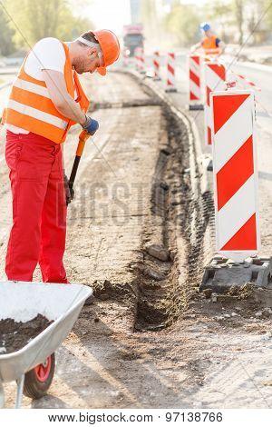 Street Worker Repairing Road