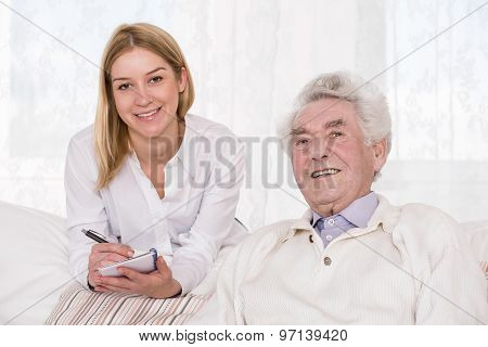 Care Assistant And Elder Man