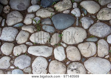 Photo of the road exactly paved with stones