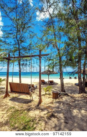 Beautiful tropical beach with swing and trees under blue sky at Phu Quoc island  in Vietnam.