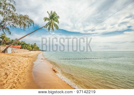 Beautiful tropical beach with  sea view, clean water & gloomy sky at Phu Quoc island  in Vietnam.