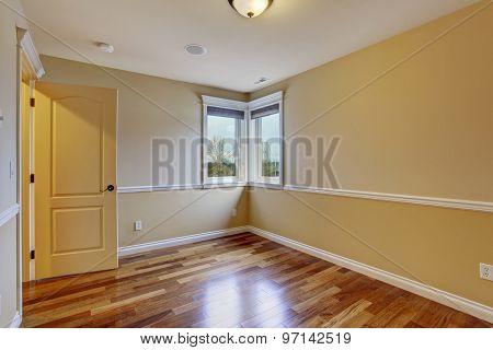 Unfurnished Room With Hardwood Floor.