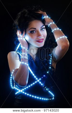 Beautiful Young Brunette With Fairy Lights