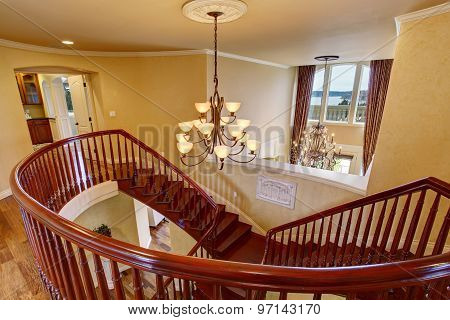 Elegant Double Staircase With A Chandelier.