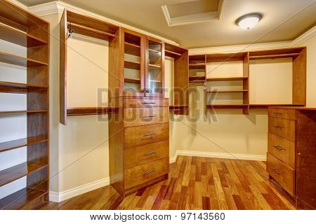Large Walk In Closet With Many Shelves And Drawers.