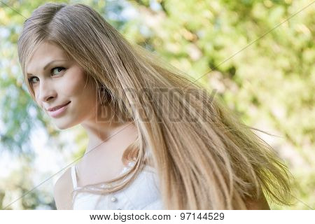 young happy girl on natural green background, smiling happy girl outdoor portrait
