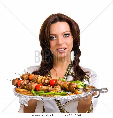 Waiters carrying plates with meat on white background