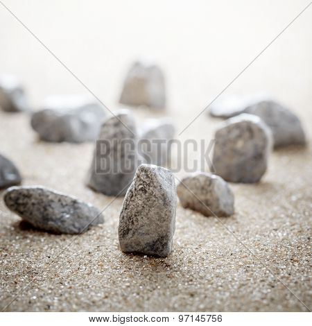 Group Of Stones On Sand.