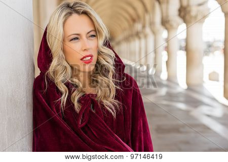 Portrait of woman in vintage red cloak
