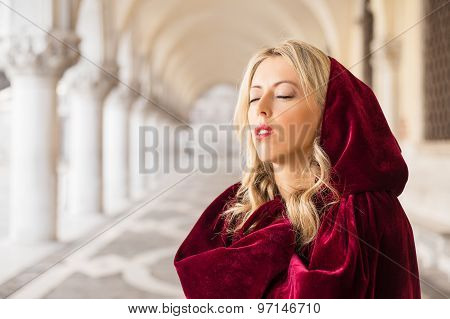 Portrait of mysterious woman in red cloak