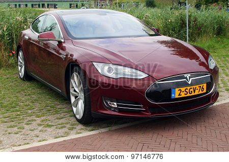 Multi-coat Red Tesla Motors Model S - Front view