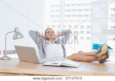 Smiling businesswoman relaxing on her office in her office