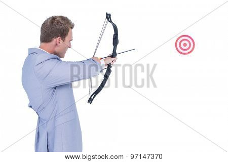 Businessman shooting target with arrow and bow on white background