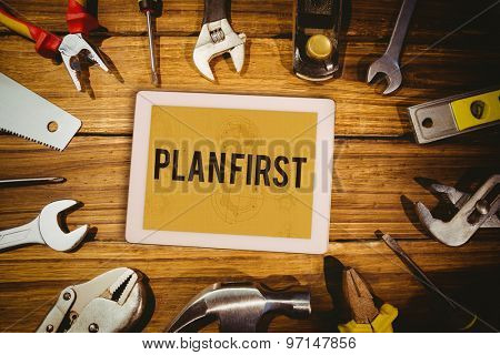 The word plan first and tablet pc against architect background