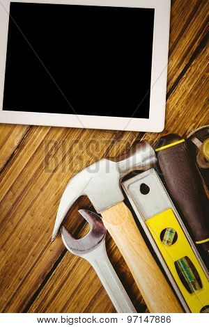 Tablet pc against desk with tools