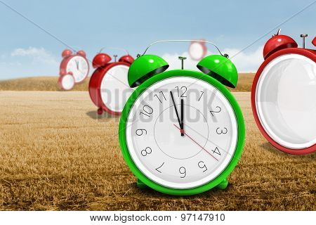 Clocks against bright brown landscape