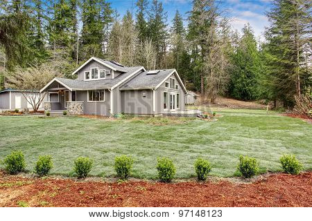 Lovely Back Yard With Porch, And Grass.