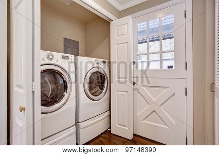 Small Laundry Area With Washer And Dryer.