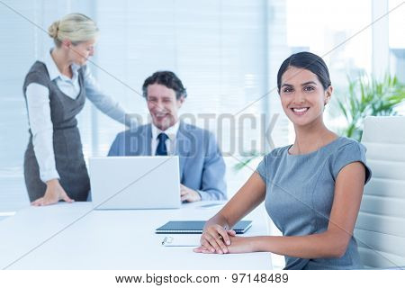 Business people in discussion in an office at work