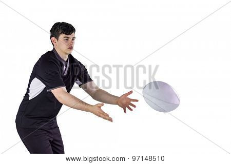 Rugby player throwing a rugby ball on a white background