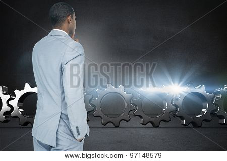 Thinking businessman against black wall
