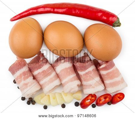 Rolled Pieces Of Bacon, Pepper, Garlic And Chicken Eggs