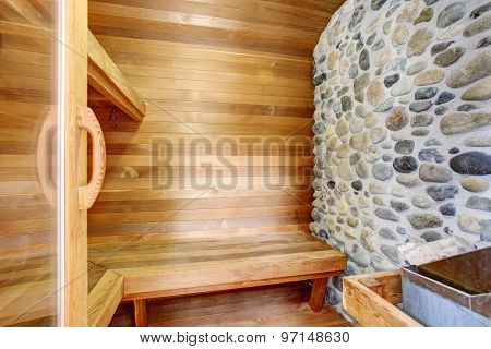 Perfect Sauna Room With Wood Walls And Bench.