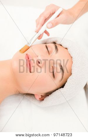 Close-up of an attractive young woman receiving massage at spa center