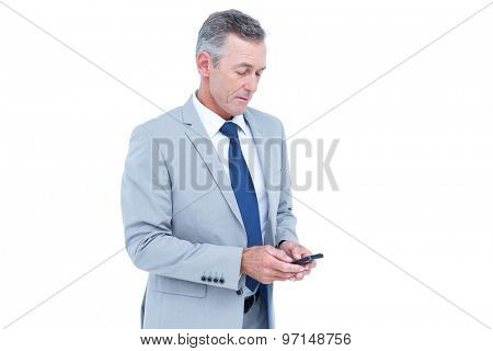 happy businessman playing with his smartphone against a white screen