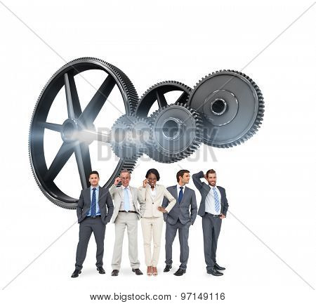 Business team against metal cogs and wheels connecting