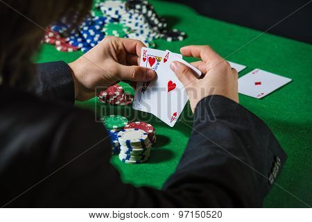 Man In Casino With Couple Of Ace And King