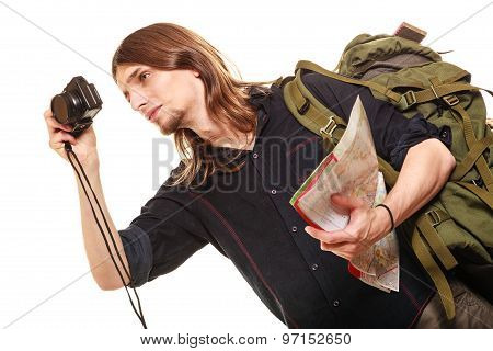 Man Tourist Backpacker Taking Photo With Camera.